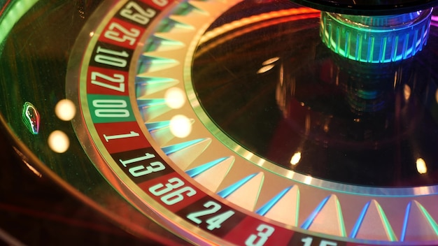 French style roulette table for money playing in las vegas, usa. spinning wheel with black and red sectors for risk game of chance. Premium Photo