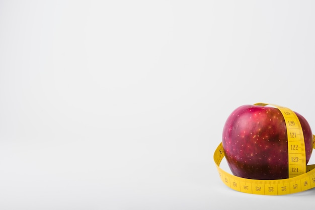 Fresh apple and tape Free Photo