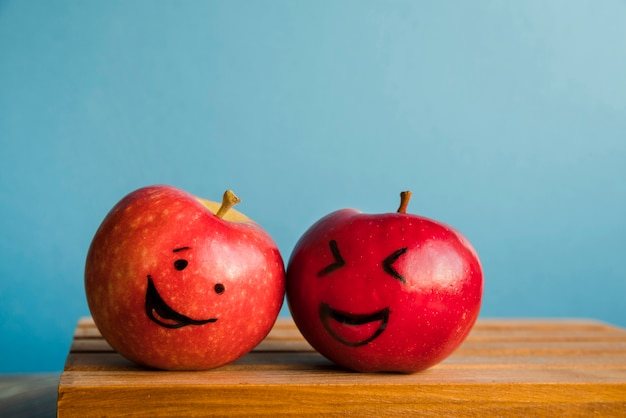 Fresh apples with funny faces Free Photo