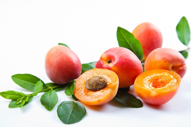 Fresh apricots with leaf on white Premium Photo