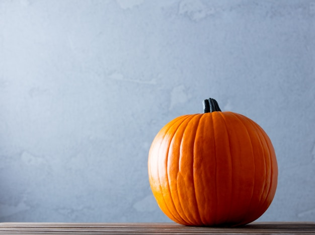 Fresh autumn pumpkin on wooden table Premium Photo