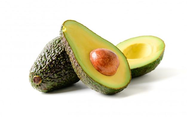 Fresh avocado. sliced avocado fruit isolated on white Premium Photo