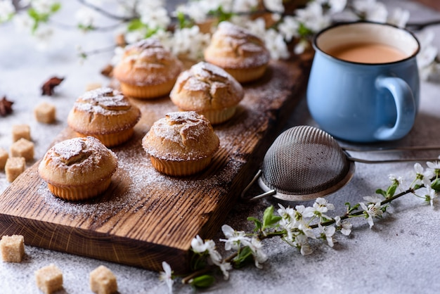 Fresh baked cupcakes of rice flour with banana and vanilla with a mug of hot chocolate. delicious invigorating breakfast with hot chocolate and cupcakes Premium Photo
