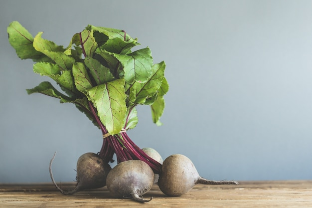 Fresh beetroot on wooden table Free Photo