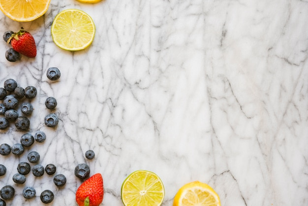 Fresh berries and slices of fruits Free Photo