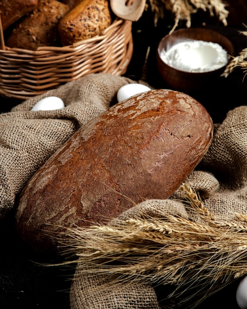 Fresh black bread on the table Free Photo