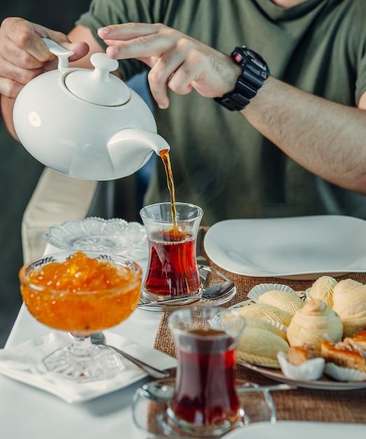 Fresh black tea with jam on the table Free Photo