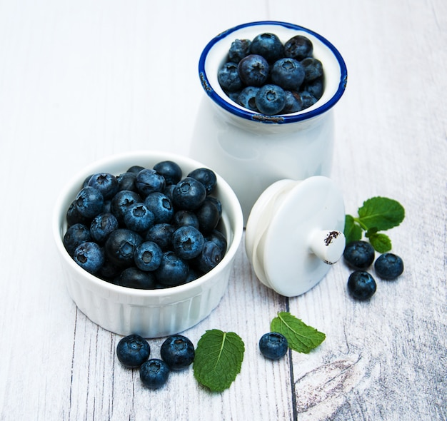 Fresh blueberries on a table Photo | Premium Download