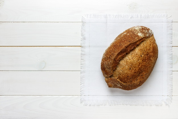 Fresh bread on wooden table Premium Photo