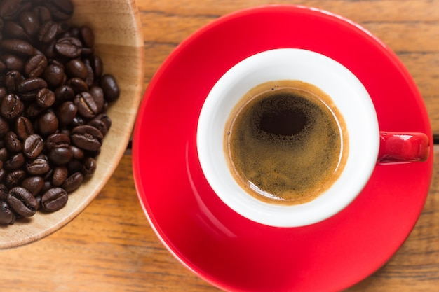 Fresh brewed hot espresso in red cup Premium Photo
