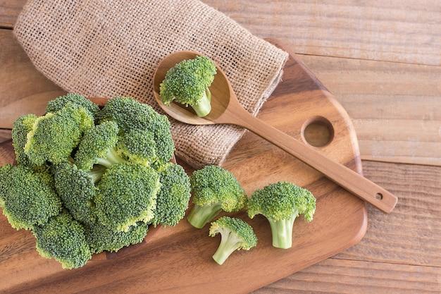Fresh broccoli over rustic wooden background Premium Photo