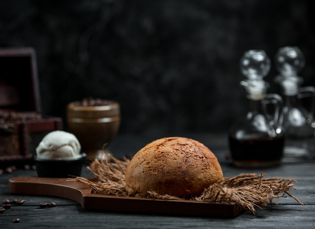 Fresh brown bread on the table Free Photo