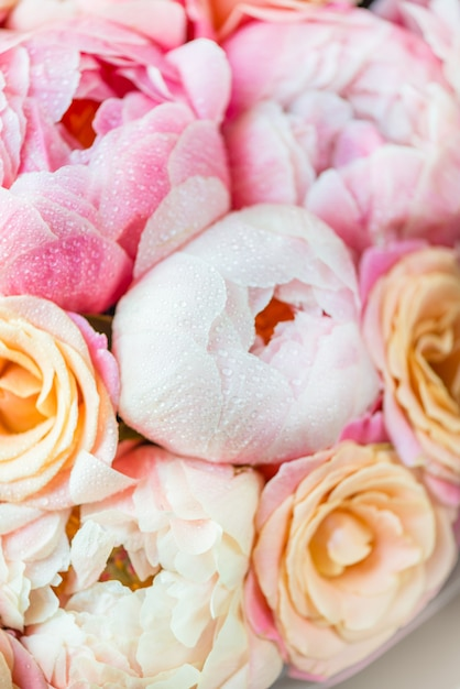 Fresh bunch of pink peonies and roses Premium Photo