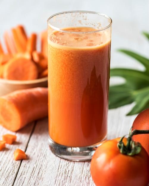 Fresh carrot juic macro shot Free Photo