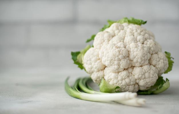 Fresh cauliflower with green onions Premium Photo