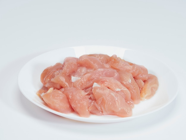 Fresh chicken tenderloin in white plate Premium Photo