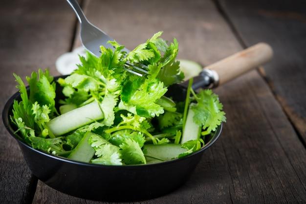 Fresh cilantro salad, coriander with cucumber salad. healthy food concept. Free Photo