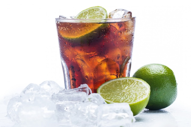 Fresh cocktail with cola drink and lime Premium Photo