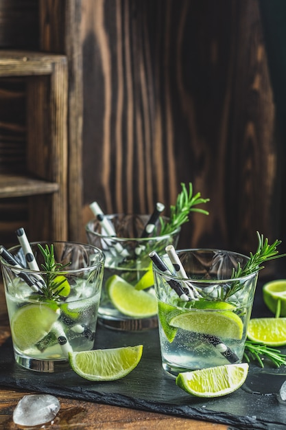 Fresh cocktail with lime, ice and rosemary Premium Photo