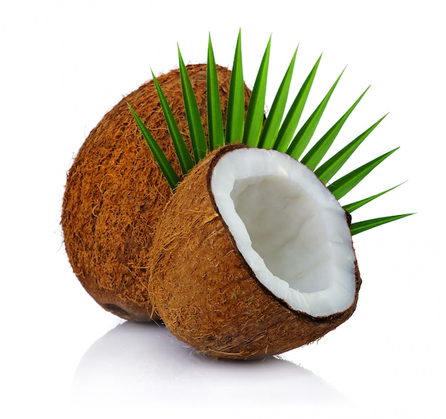 Fresh coconuts with leaf isolated on white Premium Photo
