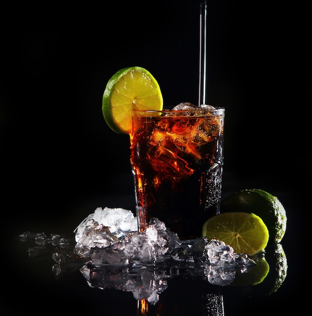 Fresh cola drink with green lime Free Photo