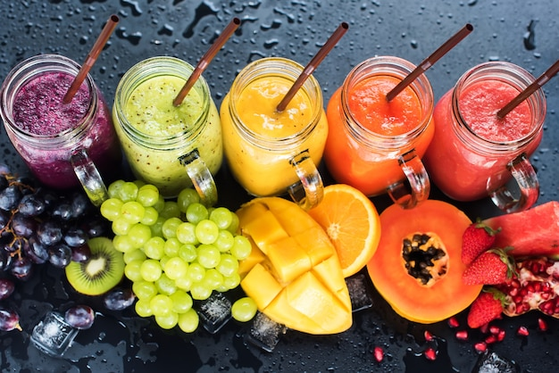Fresh color juices smoothie tropical fruits multi Premium Photo