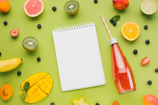 Fresh colorful flat lay with fruit and juices Free Photo