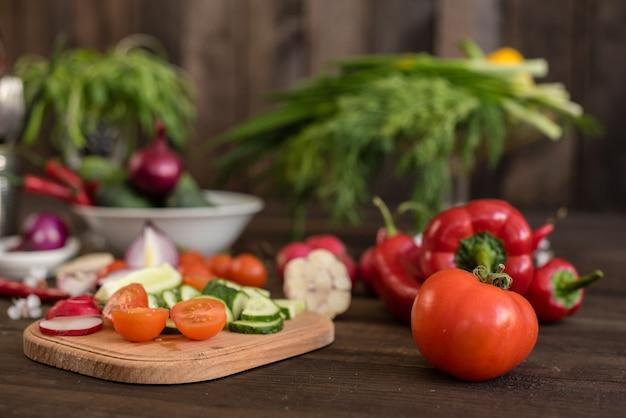 Fresh colorful vegetables from a kitchen garden on a dark wooden background Premium Photo