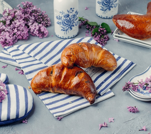 Fresh croissants on the table Free Photo