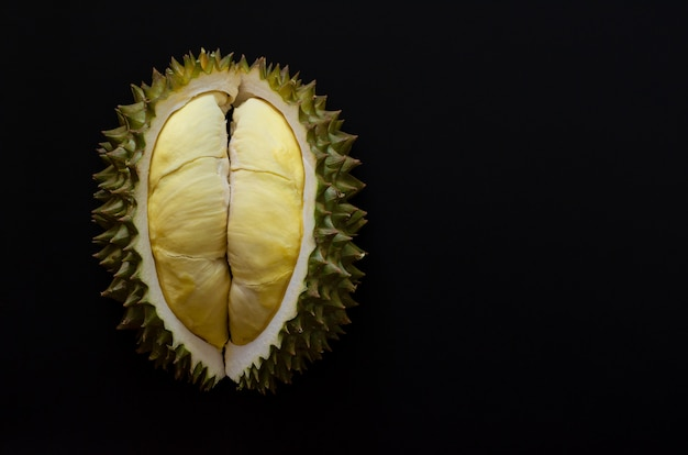 Fresh cut durian which is king of fruit from thailand isolated on black background with space for text. Premium Photo