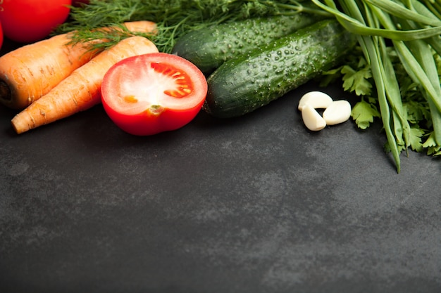 Fresh delicious ingredients for healthy cooking or salad making on rustic background, top view, banner. diet or vegetarian food concept. Premium Photo