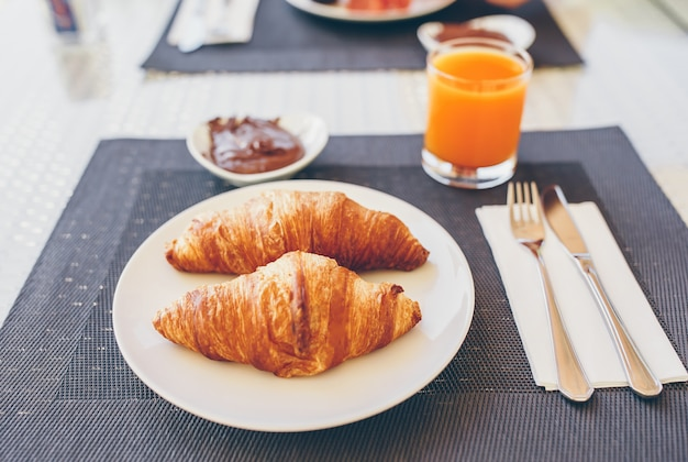 Fresh and delisious breakfast in hotel restaraunt. Premium Photo
