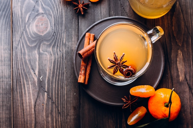Fresh drinks with spicy,citrus fruits and cinnamon in glass on wood Premium Photo