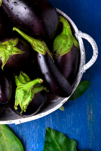 Fresh eggplant in grey basket Premium Photo