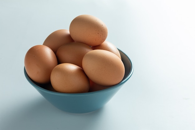 Fresh eggs in bowl. Free Photo