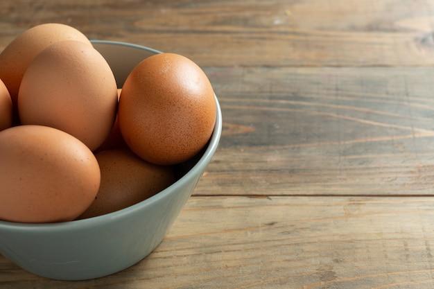 Fresh eggs in bowl. Free Photo