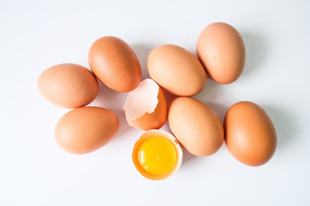 Fresh eggs from the farm placed on a white wooden table Premium Photo