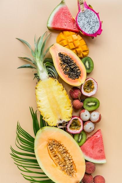 Fresh exotic fruits on orange background Premium Photo