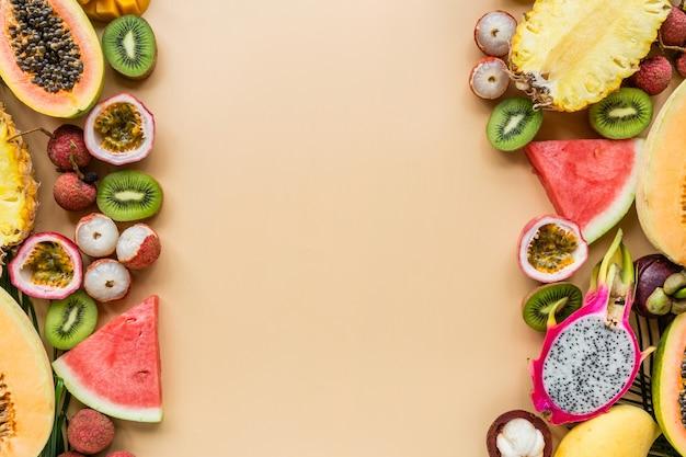 Fresh exotic fruits on pastel orange background Premium Photo