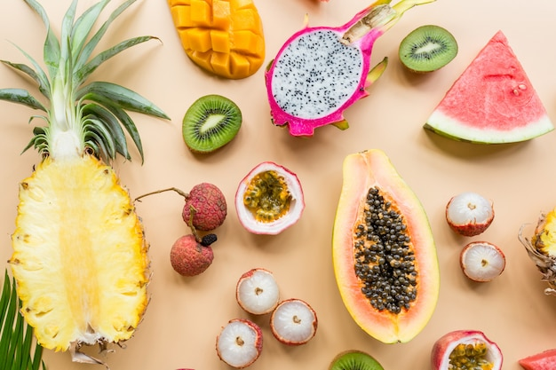 Fresh exotic fruits on pastel orange Premium Photo