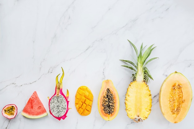 Fresh exotic fruits on white marble background Premium Photo