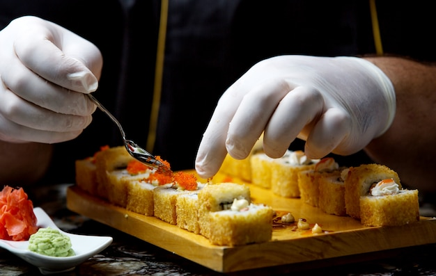 Fresh fish sushi with red caviar on the table Free Photo