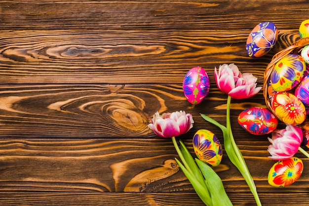 Fresh flowers near set of Easter eggs Free Photo