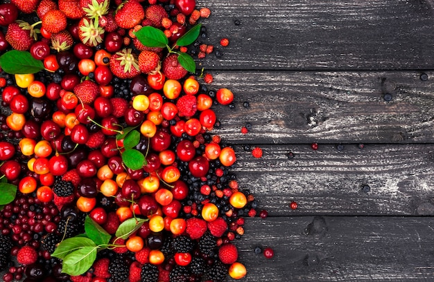 Fresh forest berries on wooden background Premium Photo