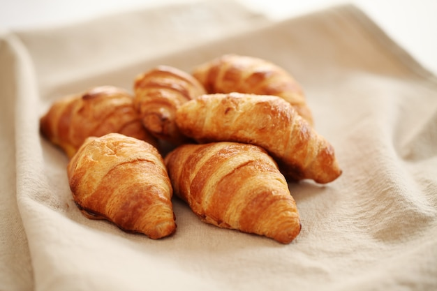 Fresh french croissants on a tablecloth Free Photo