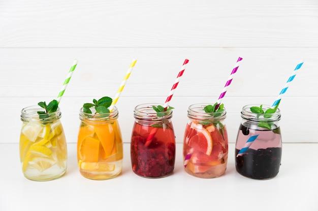 Fresh fruit jugs with straws Free Photo