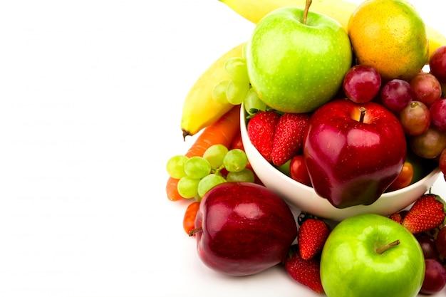 Fresh fruit on plate  isolated on white Free Photo