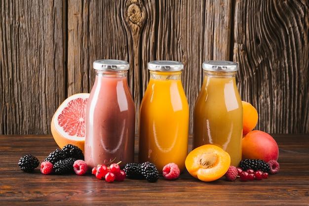 Fresh fruit smoothies on wooden background Free Photo