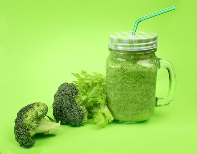 Fresh fruit vegetable broccoli celery smoothie shake lime green. Premium Photo