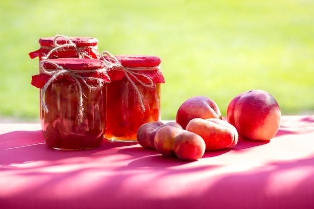 Fresh fruits and homemade jars of jam Premium Photo